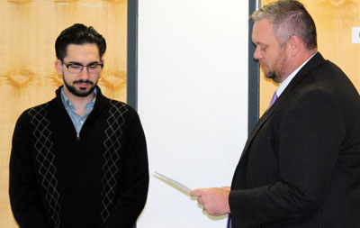 New Cayuga Community College Student Trustee Daniel Charles is sworn-in by Cayuga President Dr. Brian Durant at the November meeting of the College Board of Trustees.