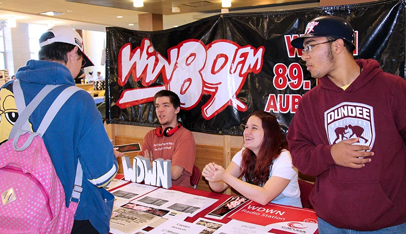 Students in the radio station booth