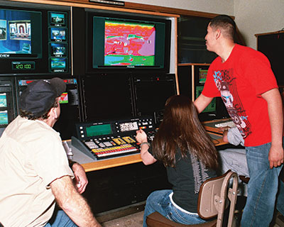 Students working in the Telcom studio on a control board