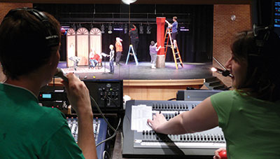 Behind the scenes in the control booth in the Bisgrove Theater