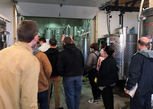 Students at the Buttonwood Grove Winery getting a tour of the facility