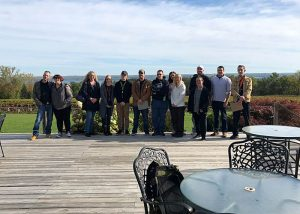 Students at the Buttonwood Grove Winery gathered together in a group photo